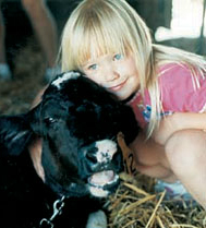 A girl and her calf.